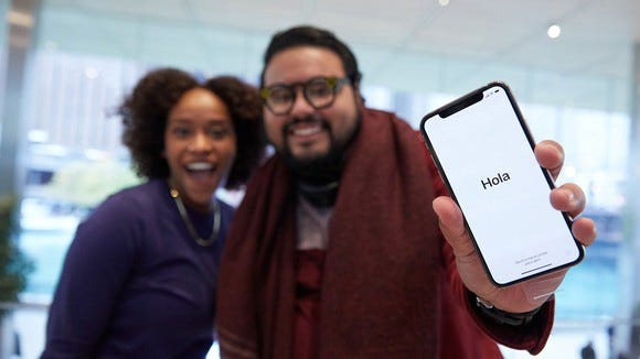 An Apple customer holding the iPhone X on launch day.