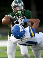 The Rams' Kyle Jackson battles with Wooster's Devon