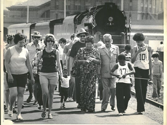 Detroiters, many in red, white, and blue, visited the Freedom Train at Michigan Central Station in July 1975