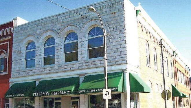 In 1996, the Ryans gave the Peterson Pharmacy building at the corner of Washington Street and Court Avenue an overhaul, replacing the roof and second story windows and tuckpointing the exterior. The structure has served as a pharmacy since the 1920s.