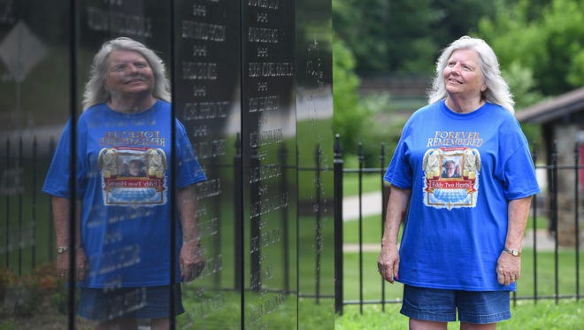 "Mary Louise Worthy at the Vietnam Memorial in Cleveland park Thursday, May 24, 2018. The memorial was designed by her late husband Floyde Edward ""Eddy"" Worthy."