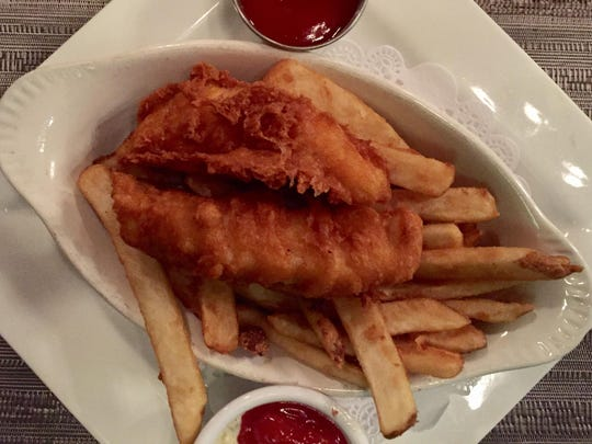 The menu for both happy hours at Rapscallion Seafood House & Bar includes a half order of Rapscallion fish and chips with ketchup and housemade cocktail and tartar sauces.