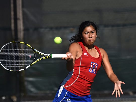 Reno's Jazlynn Parker hits a forehand return during a doubles match with partner Jil Rovetti against Manogue's Gabby Kapitiz and  Lissette Melendez during the 2017 4A Northern Region Tennis Championships on Friday.