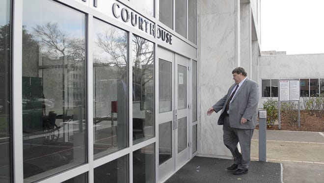 A man enters the Marion County Courthouse.