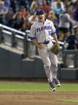 Florida Gators second baseman Blake Reese celebrates as the Gators beat TCU Saturday night to advance to the College World Series Finals that starts tonight against SEC rival LSU.