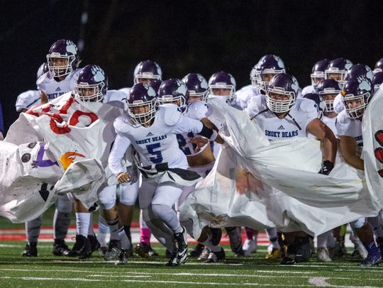Sevier County enters the field for the game against