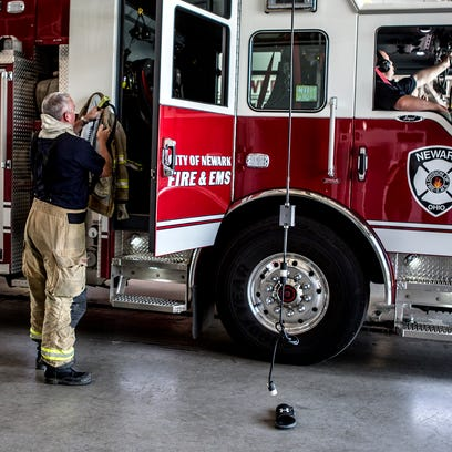 Firefighters at station 1 get ready to go on a run