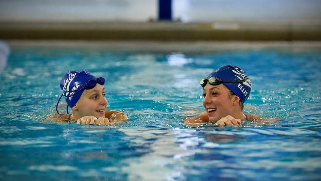 Sartell swimmers Anna Ellis, right, and Marena Kouba share conversation while swimming warm-up laps Friday, Sept. 9, 2016, at the Sartell High School pool.