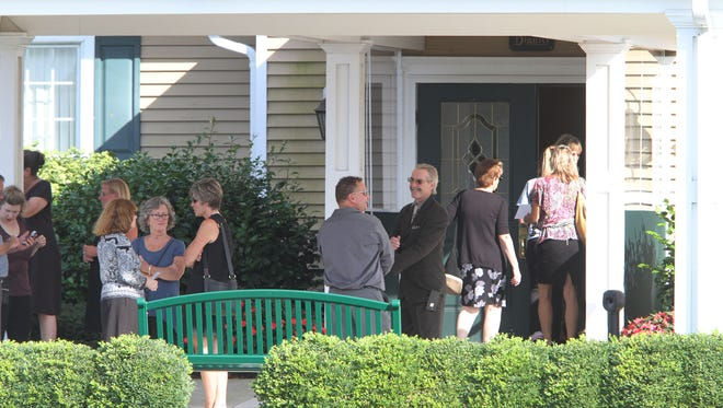 People arrive for the wake and funeral service for Kim Dunphey and her son Owen Scott at the Quinn-Hopping Funeral Home in Toms River Wednesday, August 23, 2107.  They were murdered in Lacey Township by her husband, who also killed himself.