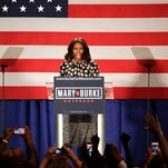 In this Sept. 29, 2014, photo, first lady Michelle Obama, speaks on behalf of  Wisconsin Democratic gubernatorial candidate Mary Burke at a campaign rally in Milwaukee. Michelle Obama is hitting the campaign trail a month before critical midterm elections to try to help Democratic candidates. The first lady starts campaigning in earnest on Friday by appearing with the gubernatorial candidates in Massachusetts and Maine.  (AP Photo/Darren Hauck)