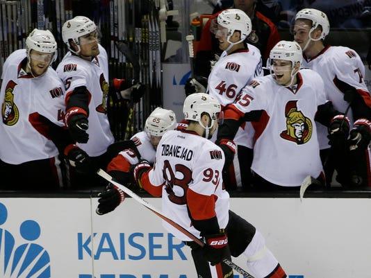 Ottawa Senators' Mika Zibanejad (93) celebrates after scoring against the San Jose Sharks during a shootout of an NHL hockey game Monday, Jan. 18, 2016, in San Jose, Calif. Ottawa won 4-3. (AP Photo/Marcio Jose Sanchez)