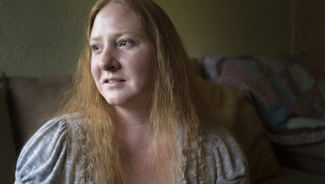 Michelle Case poses for a photo at her home in Loveland on Thursday, May 25, 2017. The mother of four has been trying to take control of her Lyme disease ever since she was diagnosed last year.