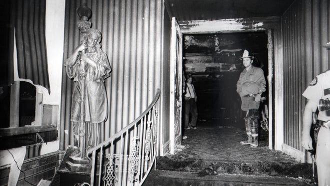 Firefighters stand inside the front foyer that leads to the main lobby at the Beverly Hills Supper Club in Southgate, Ky. Tuesday, May 31, 1977.