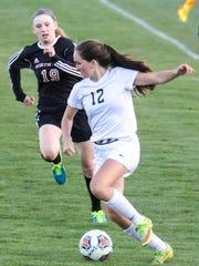 Novi's Lexi Whalen (12) tries to elude Northville's