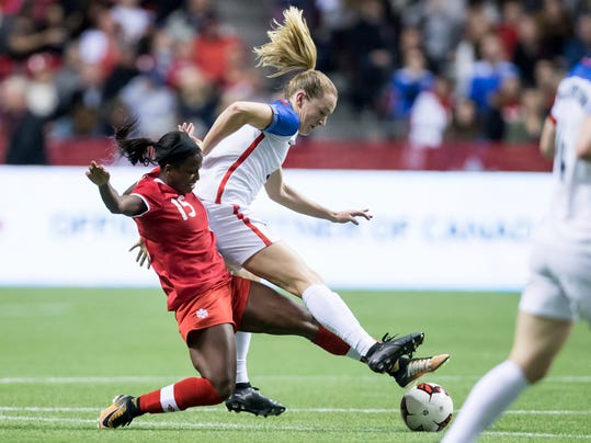 Canada's Nichelle Prince, left, and United States' Samantha Mewis vie for the ball during the first half of an international friendly soccer match, Thursday, Nov. 9, 2017, in Vancouver, British Columbia. (Darryl Dyck/The Canadian Press via AP)