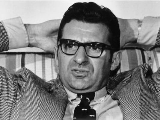 Joe Paterno talks to sportswriters in December 1971 in Dallas before the Nittany Lions took on Texas in the Cotton Bowl