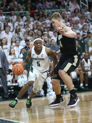 Michigan State guard Cassius Winston drives against Purdue center Isaac Haas on Feb. 10.