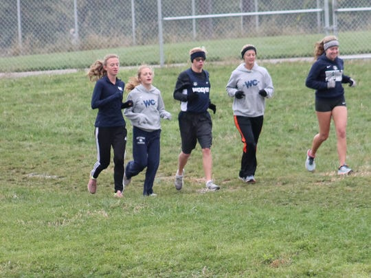Aaron Westrndorf is accompanied on the course by several members of the West Clermont girls team