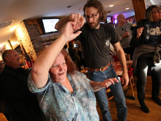 A couple dances to the music. Woody's Tavern in Farmingdale