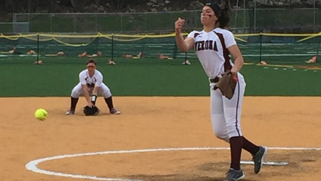 Verona's Christina Colon tosses a pitch as shortstop Amber Reed is ready defensively.