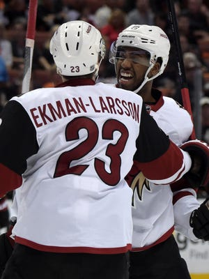 Oct. 14, 2015; Anaheim; Arizona Coyotes left wing Anthony Duclair (10) celebrates with defenseman Oliver Ekman-Larsson (23) after scoring the first of two goals in the first period against the Anaheim Ducks at Honda Center.