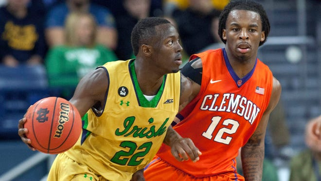 Mar 7, 2015; South Bend, IN, USA; Notre Dame Fighting Irish guard Jerian Grant (22) dribbles the ball while Clemson Tigers guard Rod Hall (12) defends in the first half of the game at Purcell Pavilion at the Joyce Center. Mandatory Credit: Trevor Ruszkowski-USA TODAY Sports