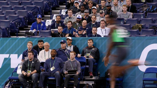 West Virginia defensive back Daryl Worley runs past scouts for NFL teams at the Scouting Combine in Indianapolis in 2016.