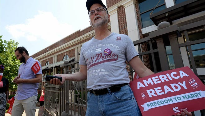Paul Hard stands outside the Montgomery County Probate Office Friday, June 26, 2015, in Montgomery, Ala., to celebrate the legalization of gay marriage.