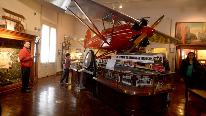 A family tours the Wayne County Historical Museum.