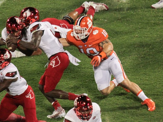 Clemson linebacker Ben Boulware sacks Louisville quarterback Lamar Jackson (8) during the first quarter on Oct. 1 at Memorial Stadium in Clemson.