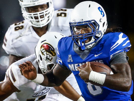 University of Memphis running back Darrell Henderson (front) scrambles past the University of Louisiana-Monroe defense for a touchdown during third quarter action at the Liberty Bowl Memorial Stadium.