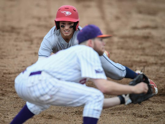 University of Southern Indiana'a Bryce Krizan (2) slides into third base while University of Evansville's Stewart Nelson (7) waits for the ball as the University of Southern Indiana Screaming Eagles play the University of Evansville Aces at Evansville's Braun Stadium Wednesday, April 25, 2018.