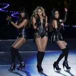 Beyonce, center, performs with Kelly Rowland, left, and Michelle Williams, right, of Destiny's Child,  at the 2013 Super Bowl. Beyonce, center, performs