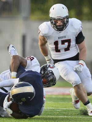 St. Cloud State's Brady Westart (17) backs up teammate Dwayne Wade (29) on a tackle of Concordia-St. Paul wide receiver Alquawn Vickers (5) in the first half Sept. 3 at Husky Stadium.