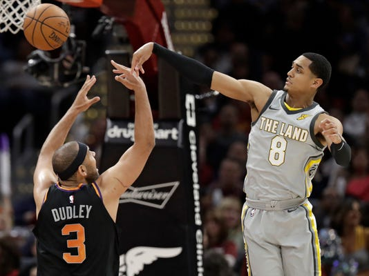 Cleveland Cavaliers' Jordan Clarkson (8) passes the ball over Phoenix Suns' Jared Dudley (3) during the second half of an NBA basketball game Friday, March 23, 2018, in Cleveland. The Cavaliers won 120-95. (AP Photo/Tony Dejak)