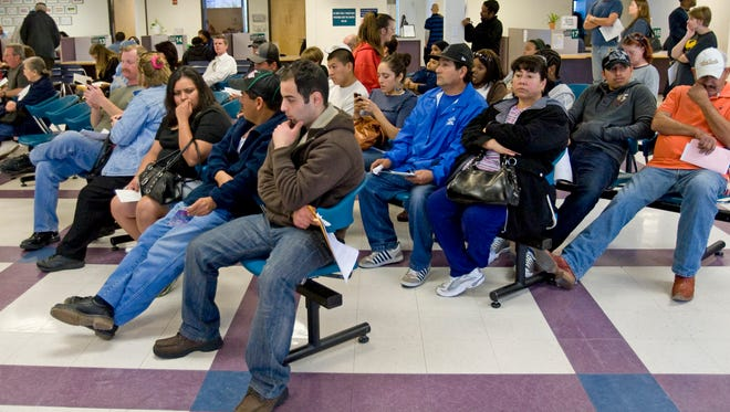 Customers wait at the MVD Central Phoenix branch for service in 2010.