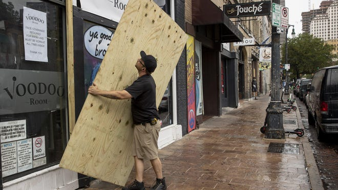 Brian, who wouldn't give his last name, boarded up the Voodoo Room on East Sixth Street on Friday after Gov. Greg Abbott closed bars in Texas due to the coronavirus pandemic.