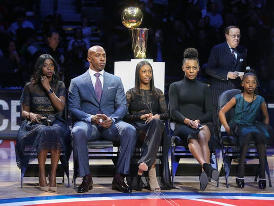 Chauncey Billups sits with his family before his jersey