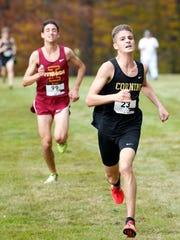 Corning's Quinn Nicholson leads Ithaca's Silas Derfel to the finish line of the Section 4 Class A cross country championships at Chenango Valley State Park on Nov. 2.