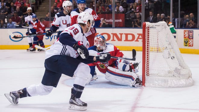 Team USA's Justin Abdelkader, left, scores on Team Czech Republic's goalie Petr Mrazek during the second period of World Cup of Hockey action in Toronto, Thursday, Sept. 22, 2016.
