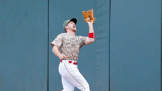 Cincinnati Reds right fielder Patrick Kivlehan (3) tracks down and catches a deep fly ball off the bat of St. Louis Cardinals center fielder Tommy Pham (28) in the top of the second inning against the St. Louis Cardinals at Great American Ball Park on June 6, 2017.
