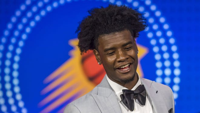 Phoenix Suns player Josh Jackson reacts after receiving the number one pick during the 2018 NBA draft lottery.