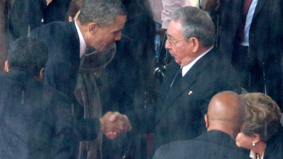 President Obama shakes hands with Cuban President Raul