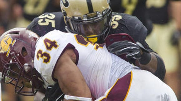 Purdue's Ja'Whaun Bentley stops Central Michigan's Thomas Rawls Saturday, September 6, 2014, during their game at Ross-Ade Stadium in West Lafayette. Purdue loss 38-17 win.