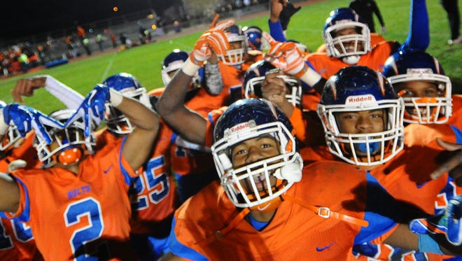 Millville players celebrate after defeating Cherokee 22-14 in a group 5 first round playoff game on Friday. 11.11.16 Joe Warner/For the Courier-Post