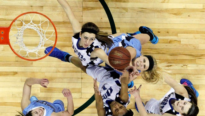 Superior's Jessica Lindstrom (blue with black headband) battles Oak Creek's Stephanie Kostowicz (top left) and Tamya Sims (15) for a rebound during the first half of their Division 1 championship game in the WIAA state girls basketball tournament Saturday, March 22, 2014 at the Resch Center in Ashwaubenon, Wis.