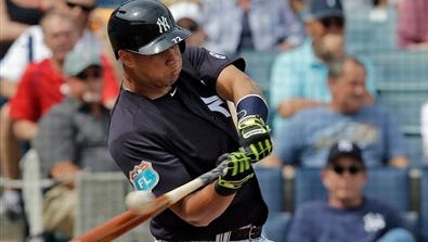 New York Yankees' Gary Sanchez bats against the Philadelphia Phillies during the second inning of a spring training baseball game Thursday, March 3, 2016, in Tampa, Fla.
