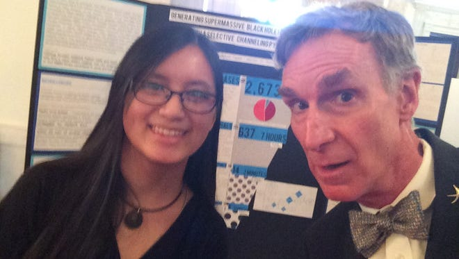 Kaisa Crawford-Taylor, left, poses with Bill Nye the Science Guy during the 2016 White House Science Fair April 13, 2016.
