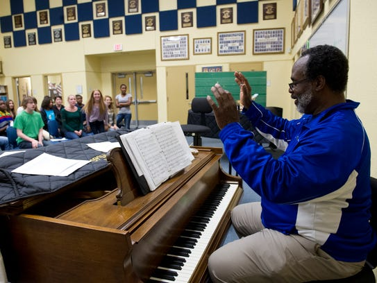 Ronald Corbin, right,  rehearses with his OPUS students at Martin County High School in Stuart shortly before his retirement in this Monday, May 5, 2014, photo.