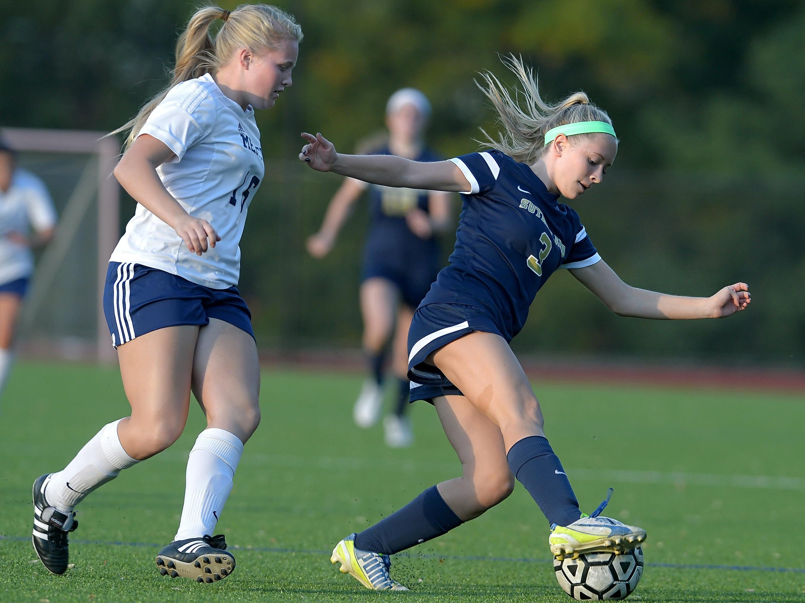 Pittsford Sutherland's Julia Stone, right, turns the ball away from Mercy's Ingrid Donnan.
